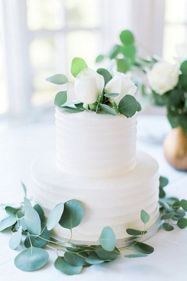 modern white wedding cake with eucalyptus