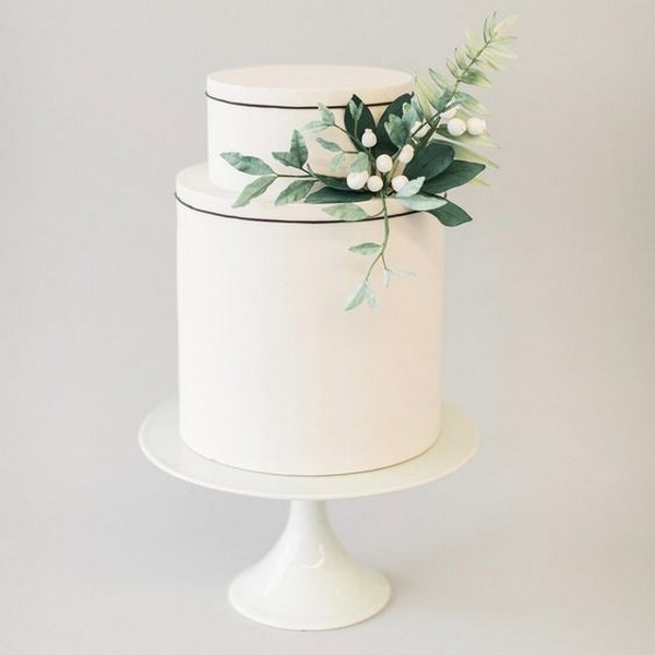 simple but elegant white and green wedding cake