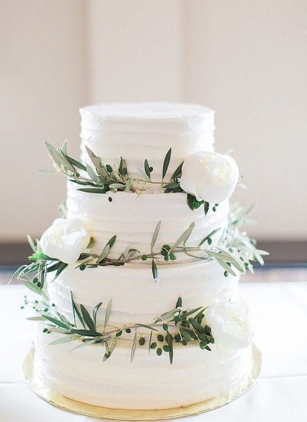 simple greens and white flowers wedding cake