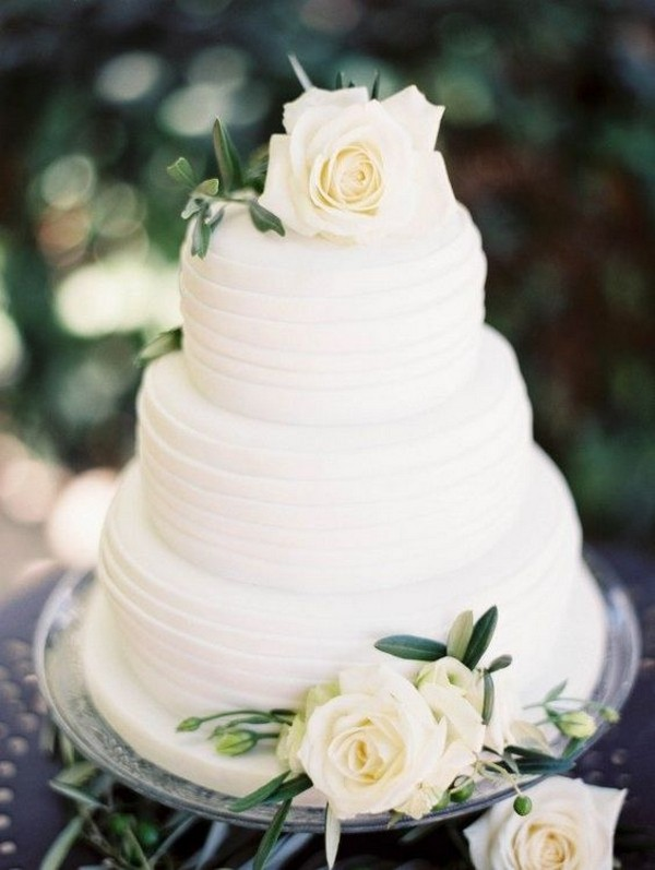 white rose adorned three tiers wedding cake
