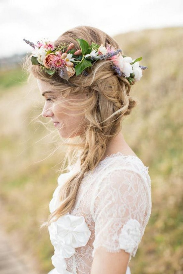 boho fishtail wedding hairstyle with flowers