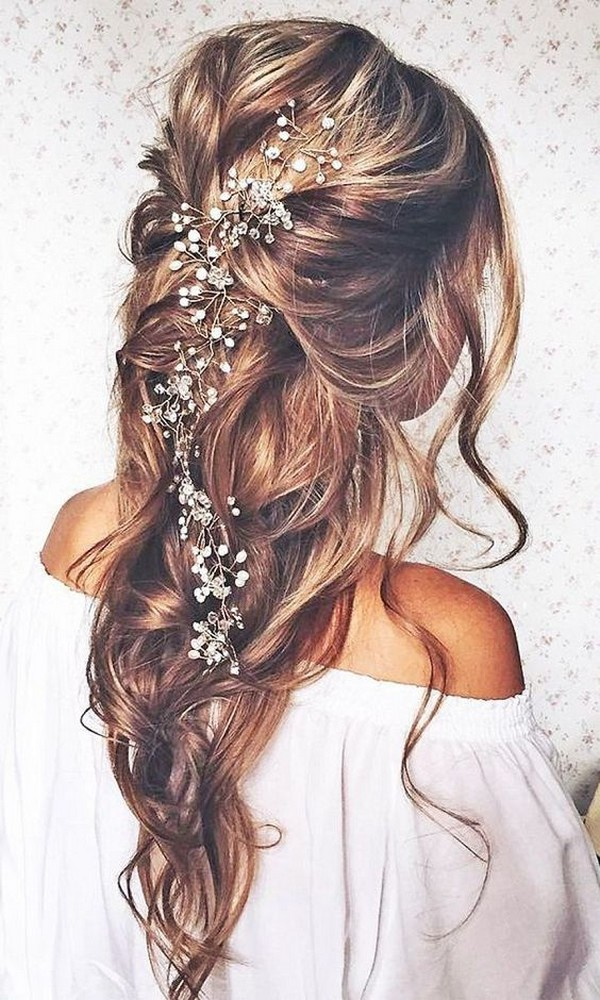 boho half up half down wedding hairstyle with headpieces