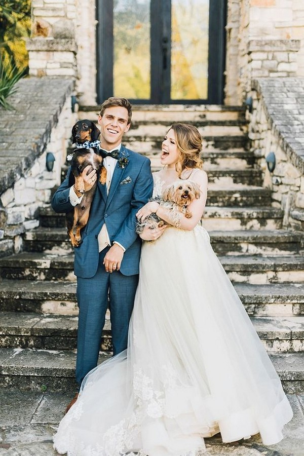 bride and groom with their dogs wedding photo ideas