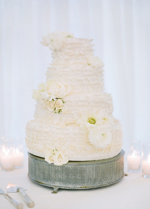 elegant all white butter cream wedding cake