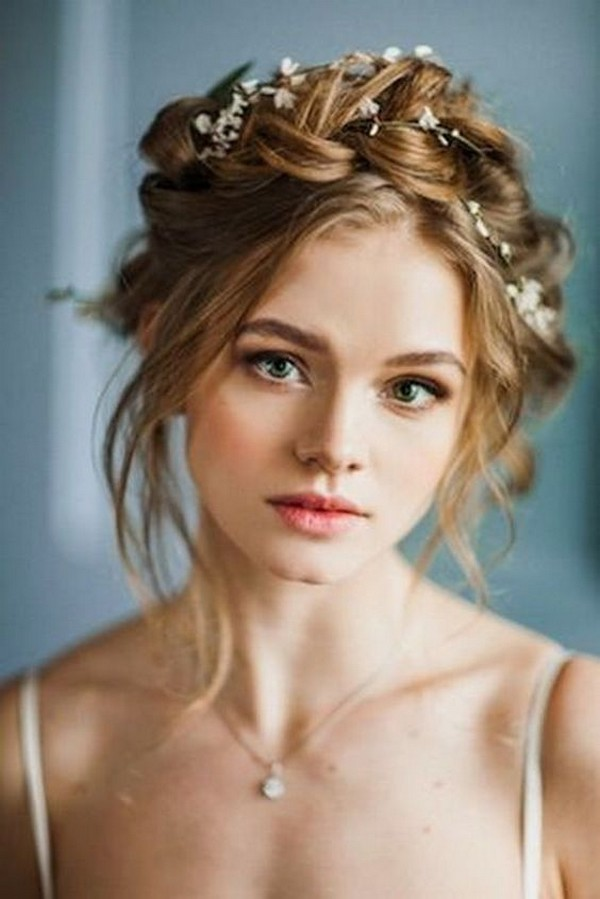 twisted updo wedding hairstyle with floral crown