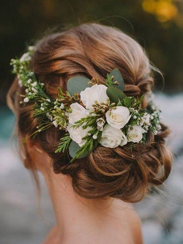 updo wedding hairstyle with white and greenery floral