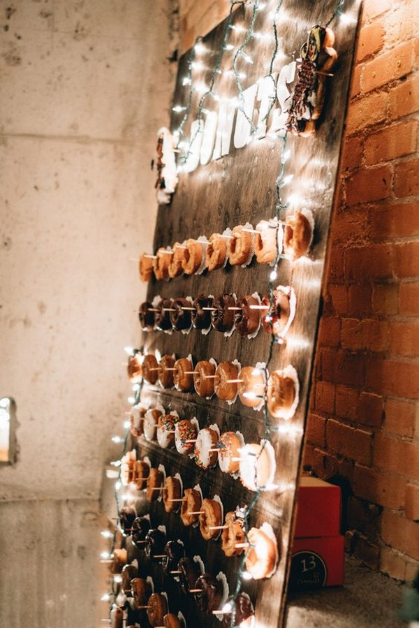 rustic wedding donuts wall with string lights decoration