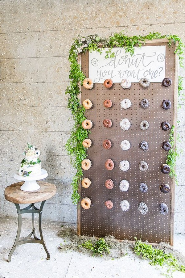 wedding donuts wall with greenery decorations