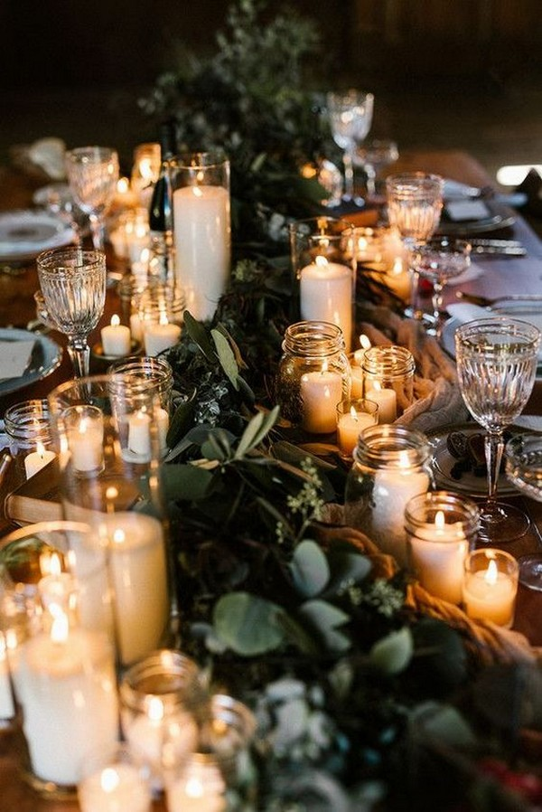 chic winter themed wedding centerpiece with candles