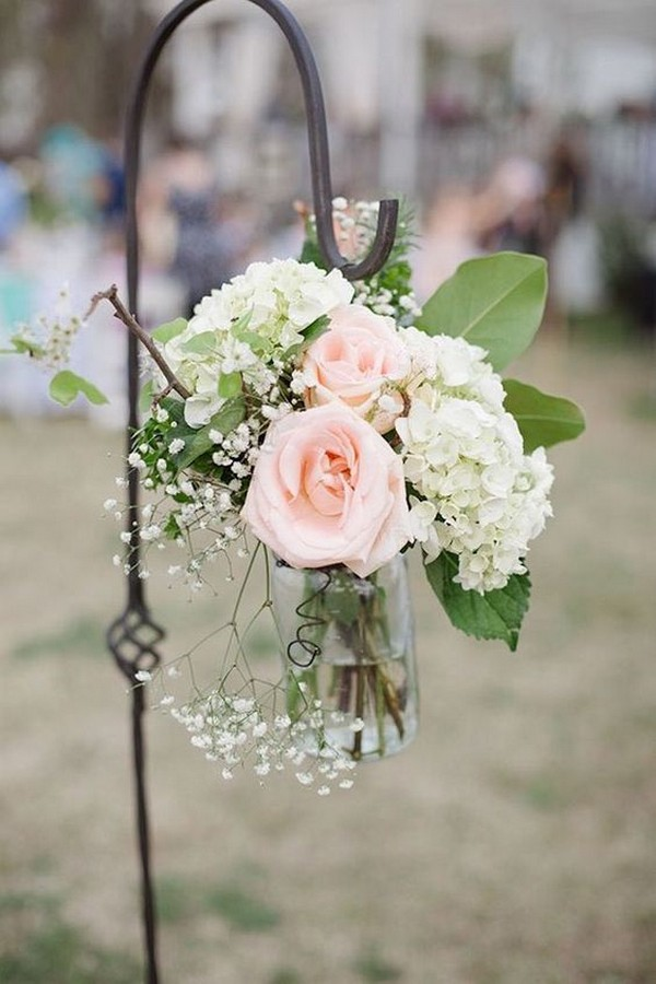 chic outdoor wedding aisle decoration ideas with mason jars and flowers