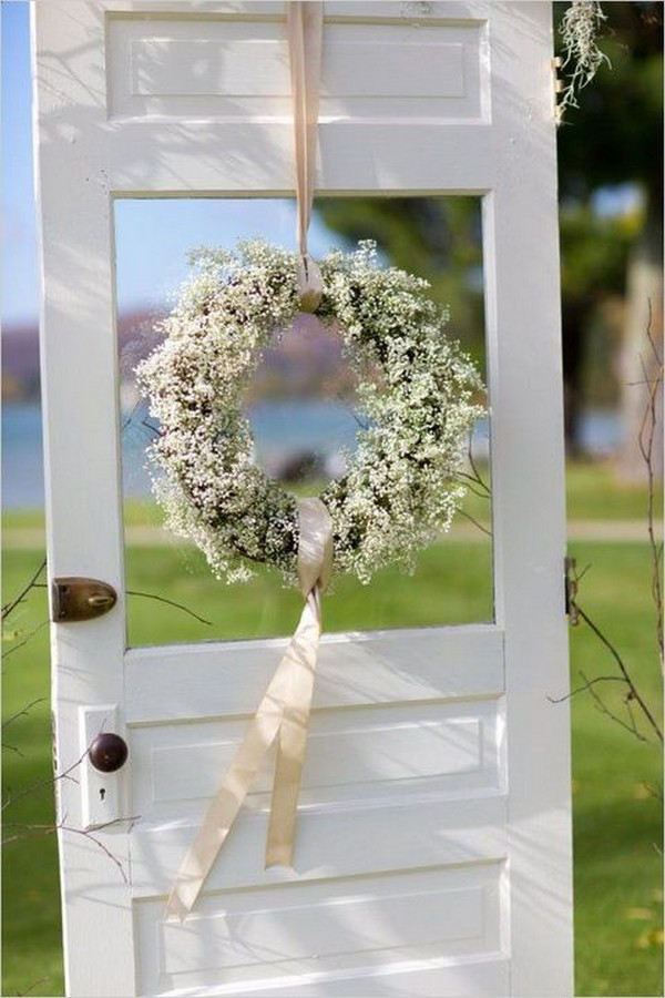 outdoor wedding decoration ideas with baby's breath and vintage door