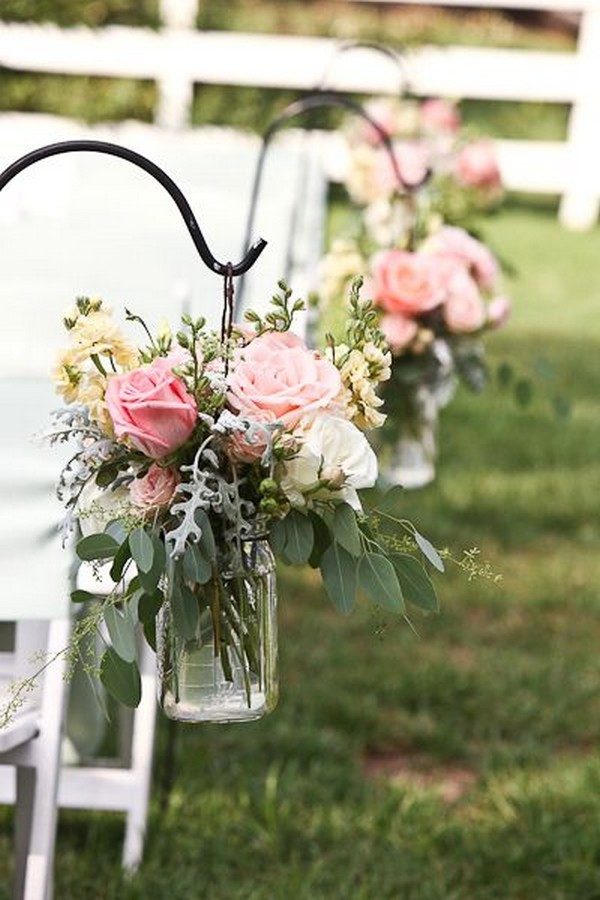 wedding aisle decors with mason jars and floral