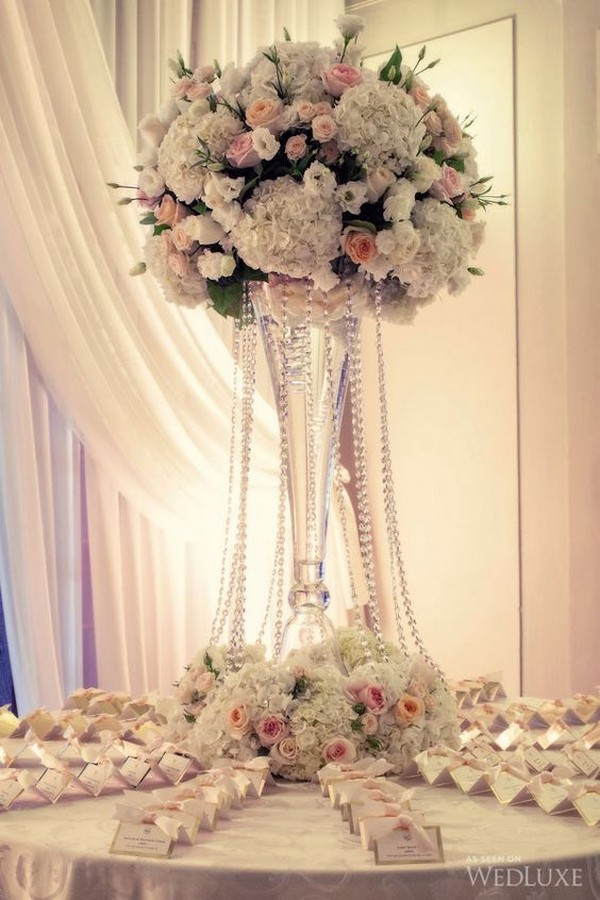 wedding place card table decorated with tall pink centerpiece