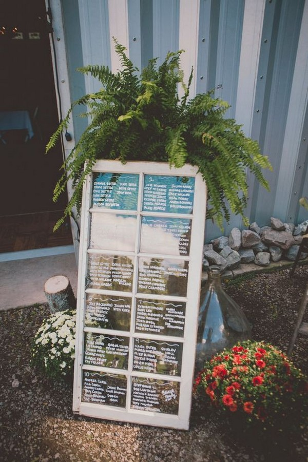 wedding seating assignment display on vintage window
