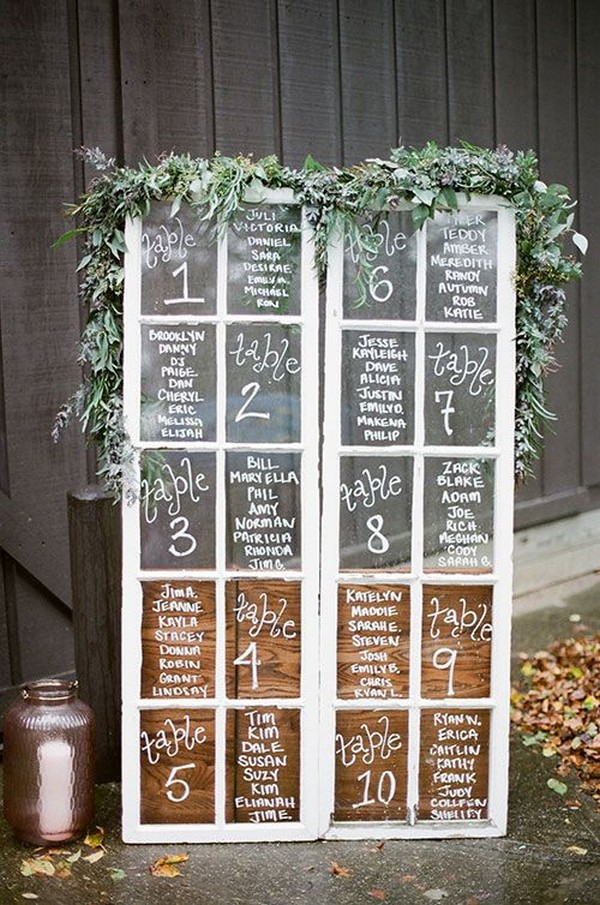 wedding seating chart display on vintage window