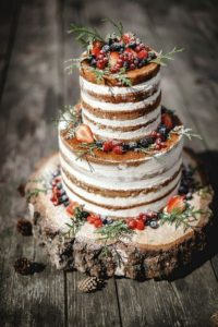 chic rustic fall wedding cake with wooden stand