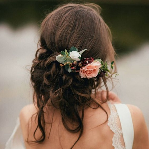 fall floral decorated fall updo wedding hairstyle