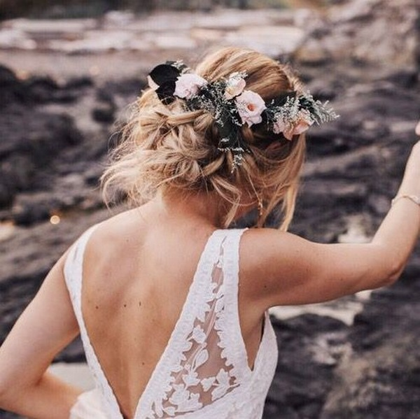 messy updo fall wedding hairstyle with flower crown