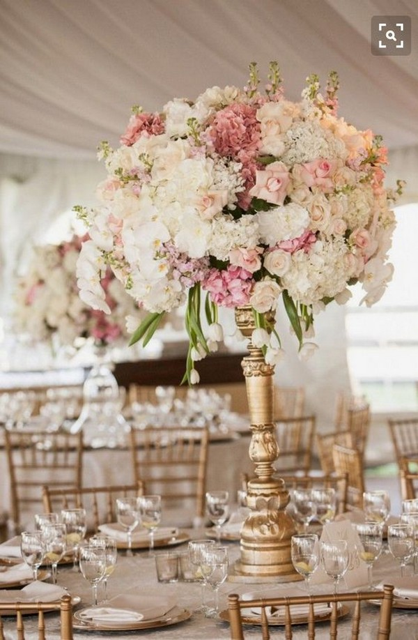 pink and gold wedding centerpiece with vintage candlestick