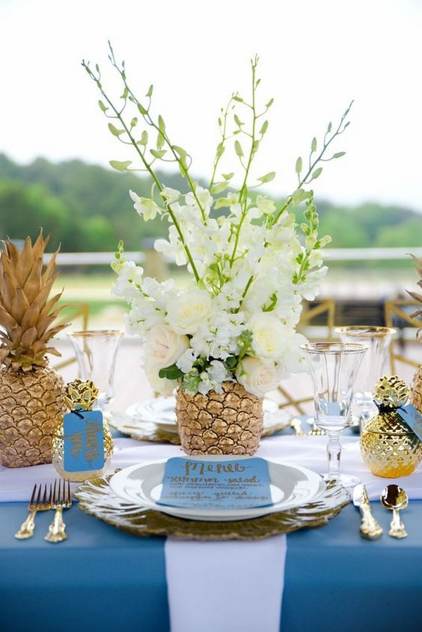 tropical wedding centerpiece with gold pineapples