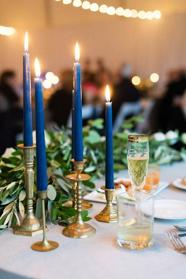 vintage gold candlesticks with navy candles wedding centerpiece