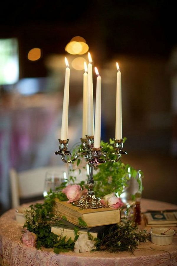 vintage wedding centerpiece with books and candlesticks