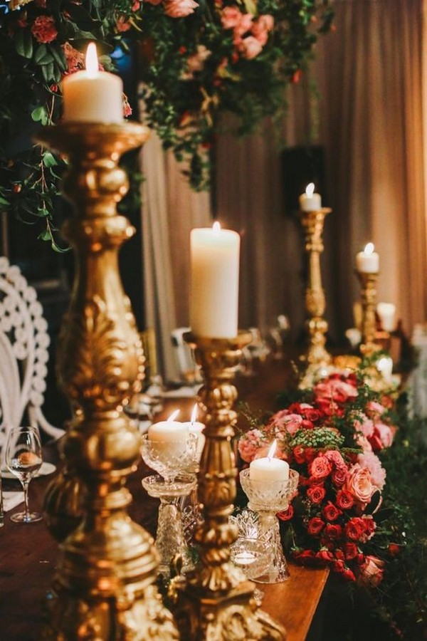 vintage wedding centerpiece with tall gold candlesticks