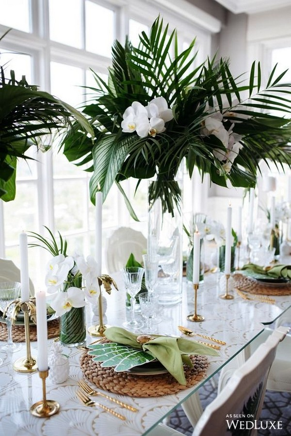 white and greenery tropical wedding centerepieces