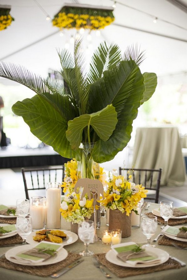 yellow and greenery tropical wedding centerpiece with palm leaf