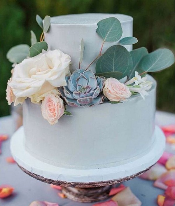 chic wedding cake with succulents and greenery