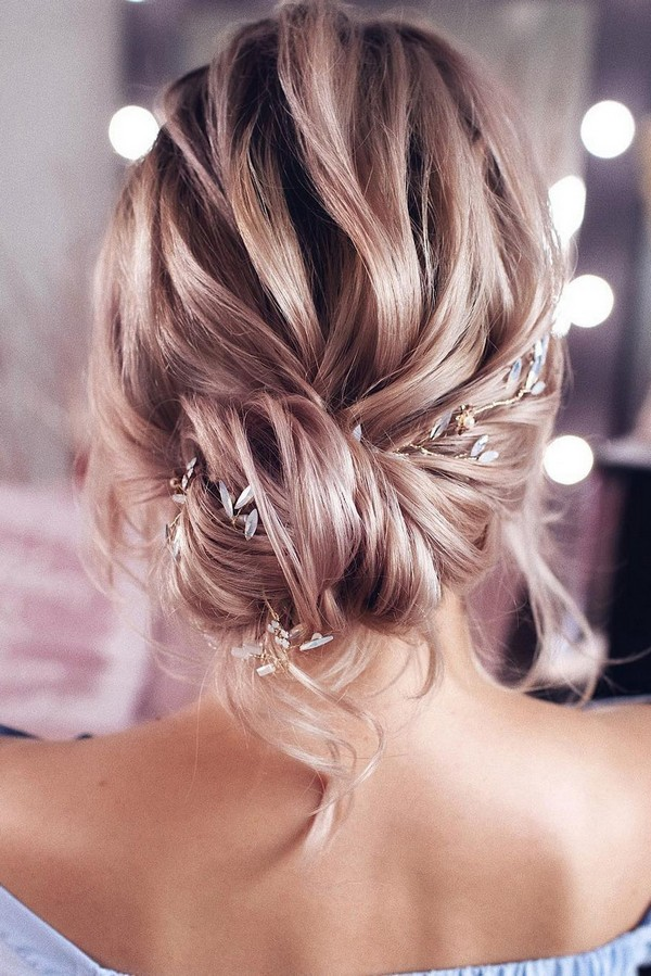 elegant low bun updo wedding hairstyle with headpieces