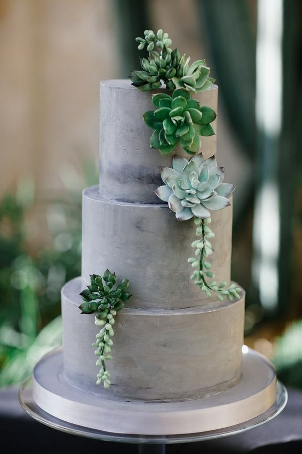 green and gray wedding cake with succulents