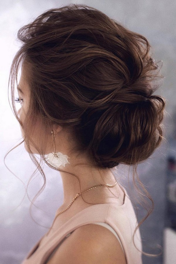 messy elegant low bun wedding hairstyle 2