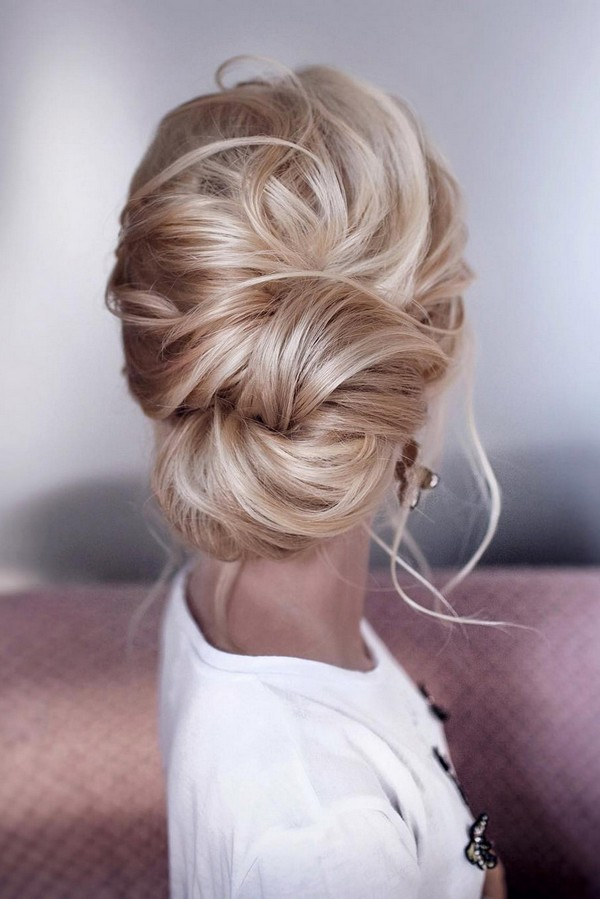 messy elegant low bun wedding hairstyle