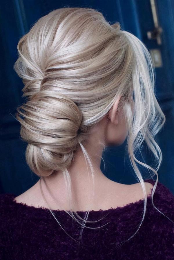 messy updo low bun wedding hairstyle