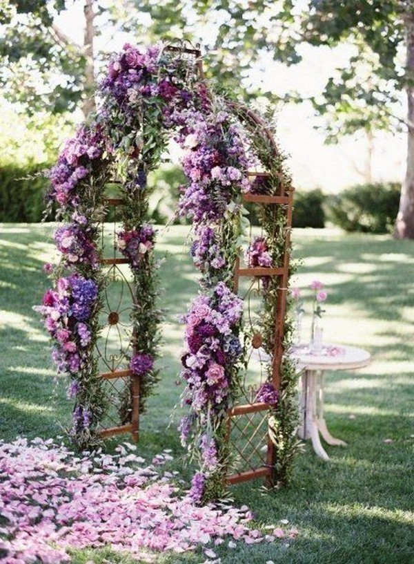 shades of purple floral decorated wedding arch ideas