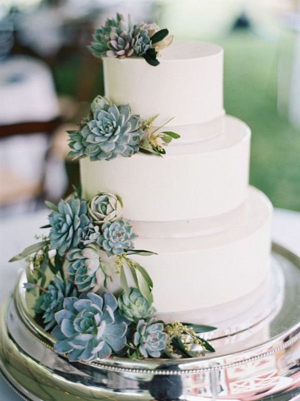 white and green wedding cake with succulents
