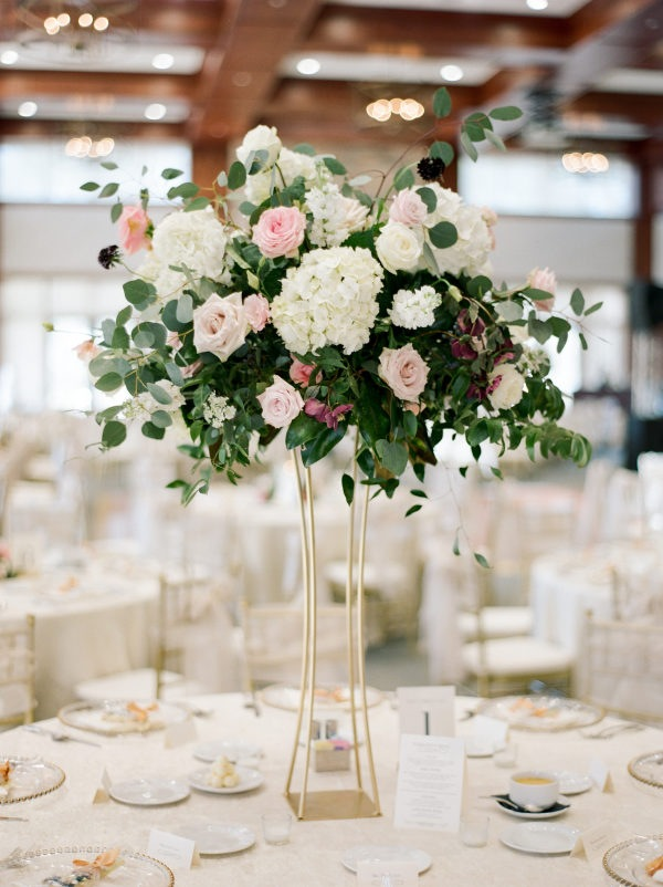 elegant tall wedding centerpiece with pink and gold colors