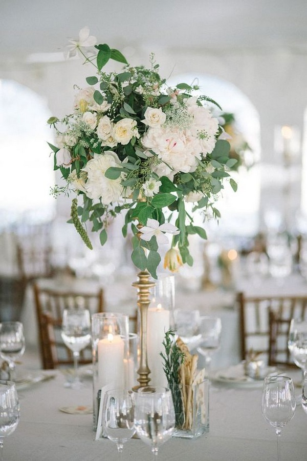 tall spring wedding centerpiece with candlestick