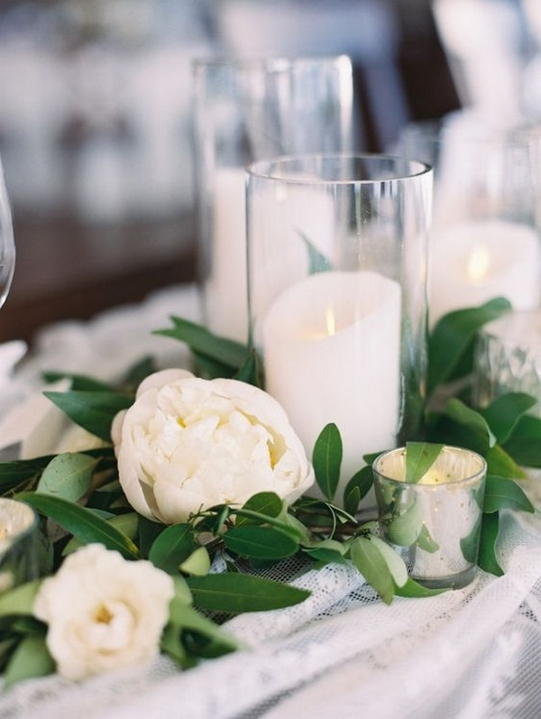 white and green elegant wedding centerpiece ideas with candles