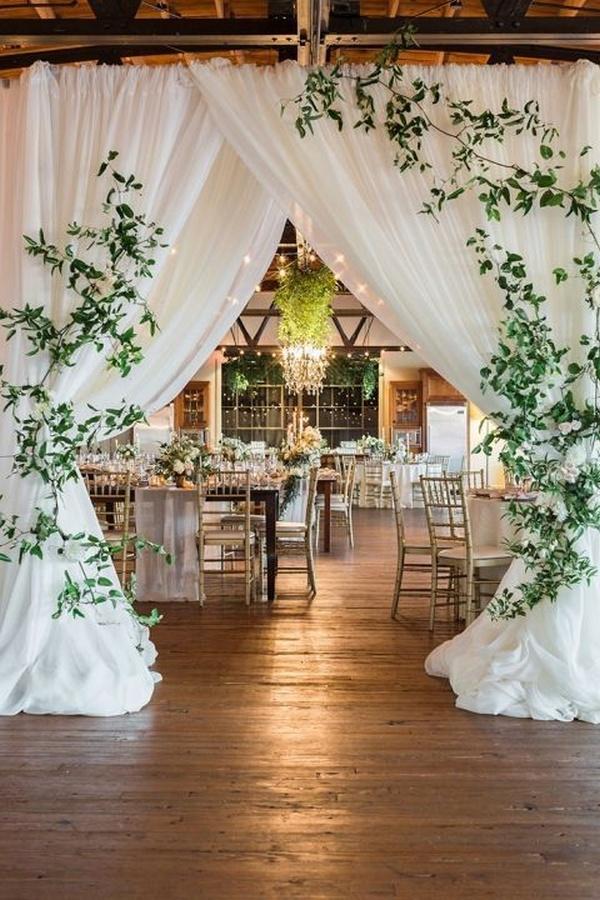 barn wedding reception ideas with a draped entrance