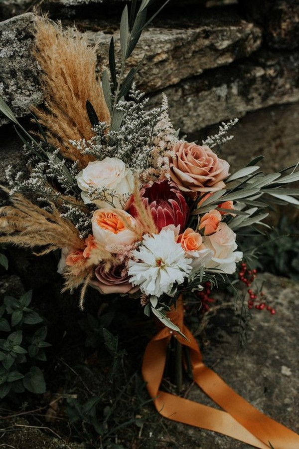 bohemian wedding bouquet with pampas grass and coral peonies