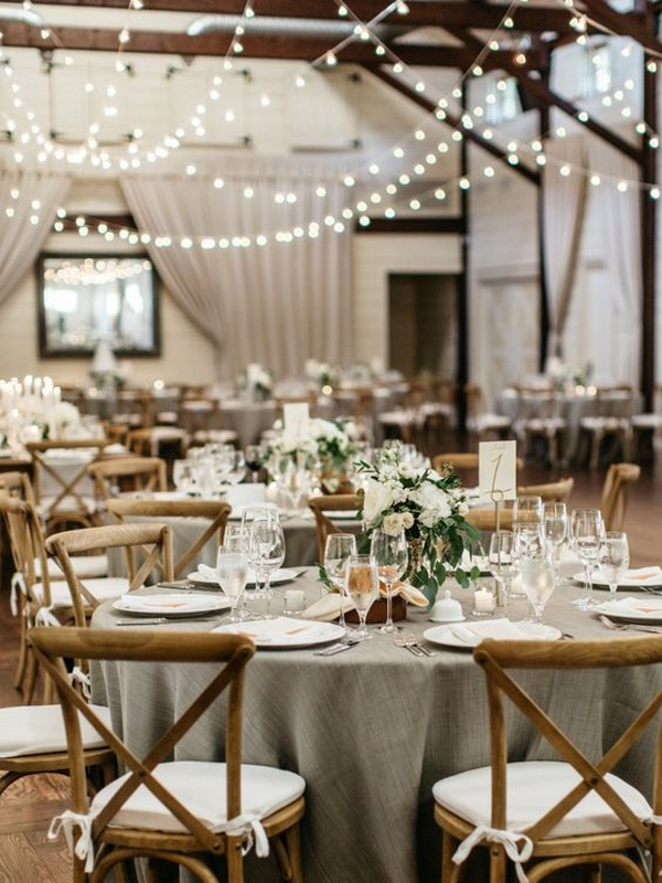 chic wedding reception ideas with string lights in a barn