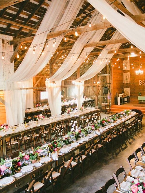 elegant barn wedding reception ideas with lights and fabric