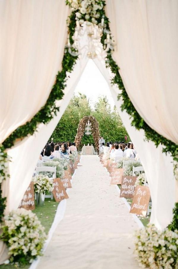 garden themed wedding entrance with garlands