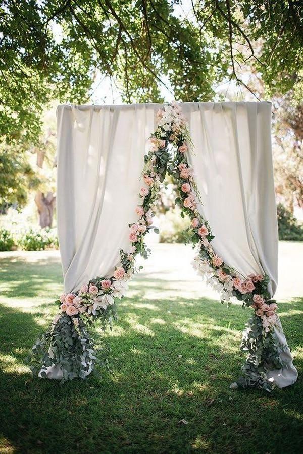 garland decorated wedding arch ideas