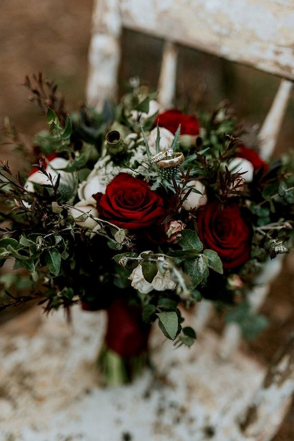 moody wedding bouquet with red roses