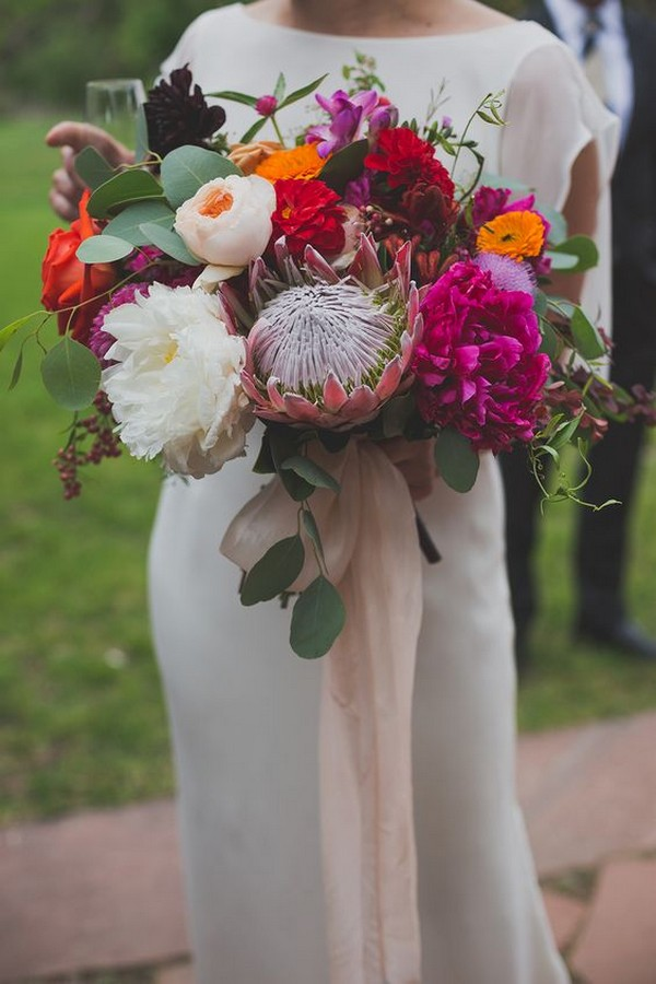 trending bohemian wedding bouquet with proteas