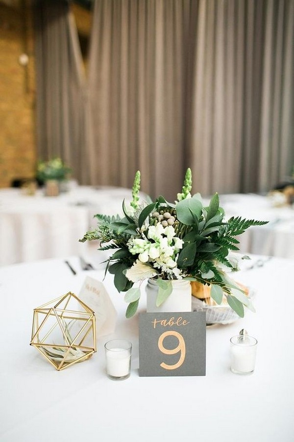 chic greenery wedding centerpiece with geometric sphere
