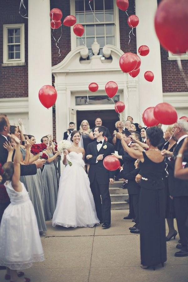 creative wedding send off ideas with red balloons
